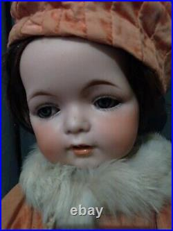 16 Charming Antique sweet faced character bebe. Bisque doll