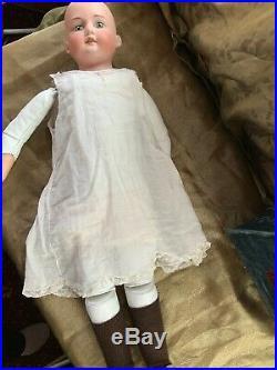 26 German Doll/ Leather Body