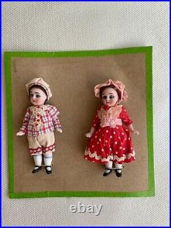 2 antique porcelain dolls on a sales card-Hertwig & Co