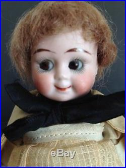 62 Rare ANTIQUE all bisque and original 329 Googly eyed doll, watermelon mouth
