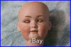Antique 15 inch Kley and Hahn closed mouth girl doll on ball jointed body