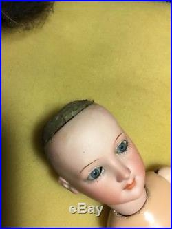 Antique bisque Young Lady Doll