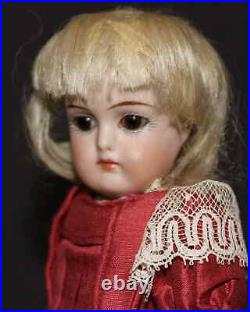 CLOSED MOUTH ANTIQUE GERMAN BISQUE DOLL by SIMON & HALBIG