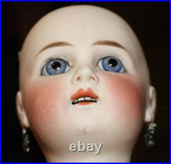 Early 16 German Wilhelm Dehle WD 7 withstraight wrists, blue spiral eyes c 1874