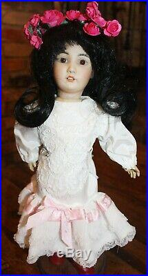 Simon and Halbig #1329 Oriental Doll with original wig plus an additional wig